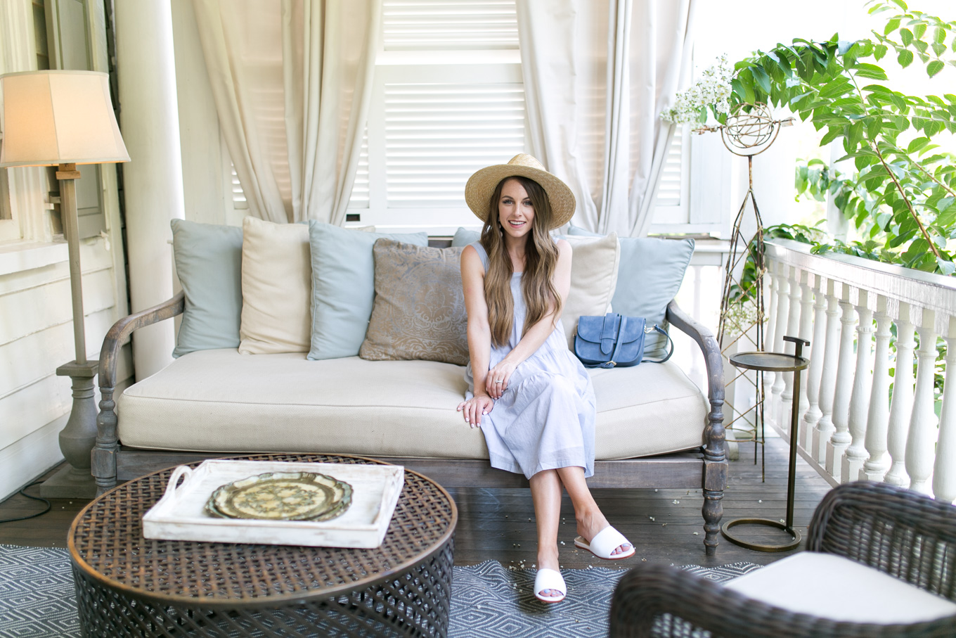 Style blogger, Daryl-Ann Denner, wears Madewell Marcelline Tiered Stripe Midi Dress and Marc Fisher Wyndi White Slide Sandals from Nordstrom in Charleston