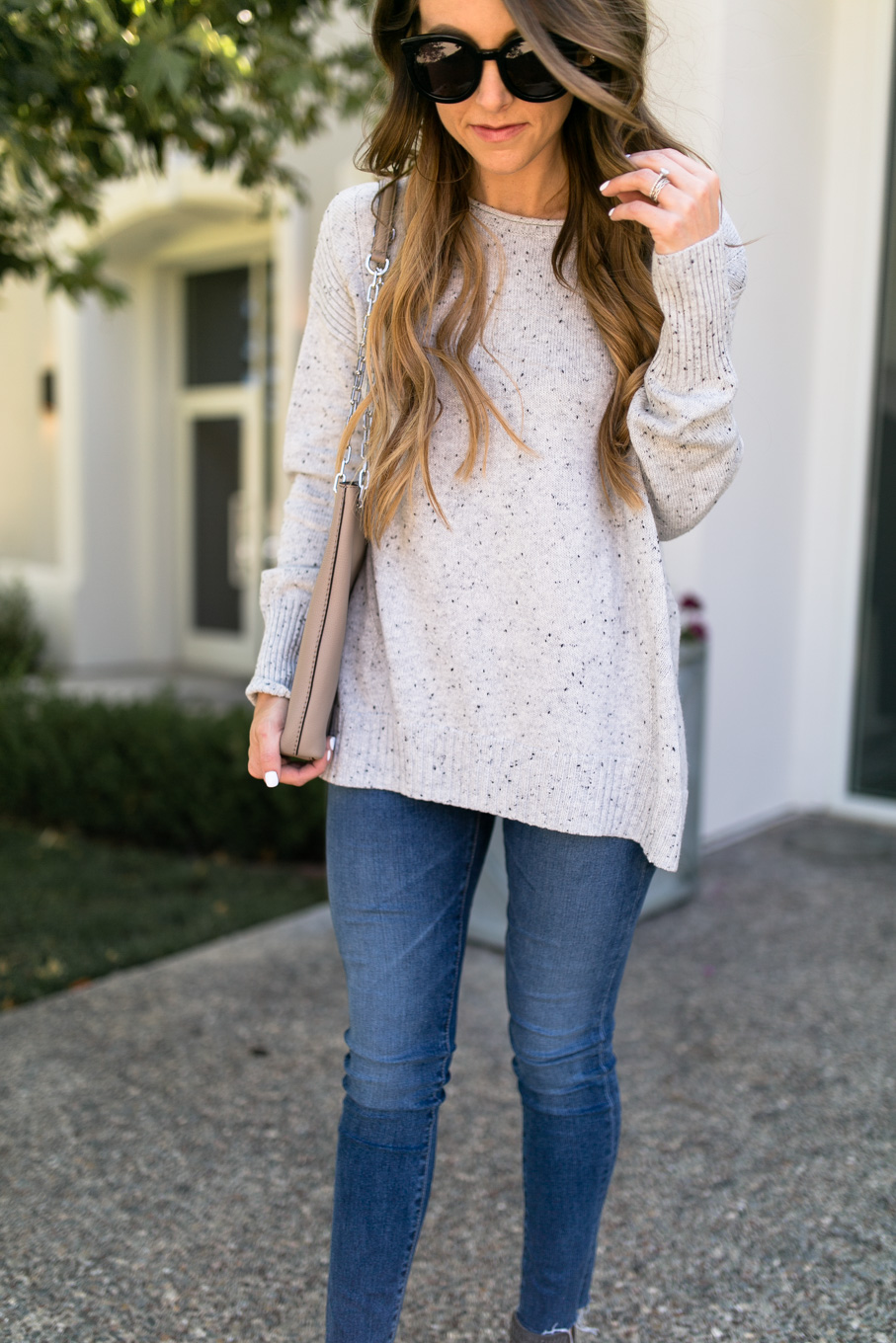 Daryl-Ann Denner wears zip-back pullover sweater from nordstrom anniversary sale 2017 with ag skinny jeans and tory burch bag