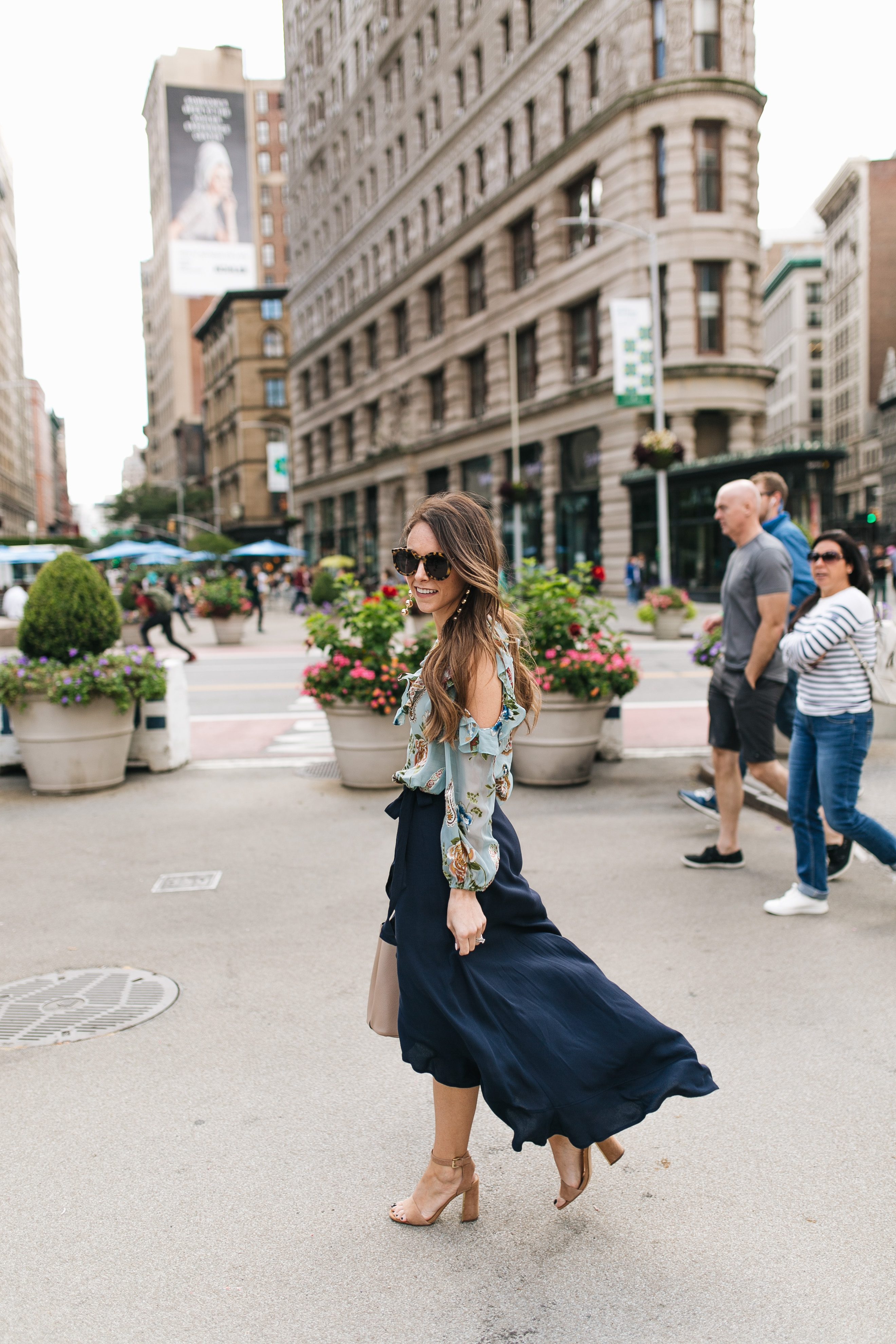 Style blogger Daryl-Ann Denner wears ruffle midi skirt and alice and olivia top at flatiron building during new york fashion week 2017