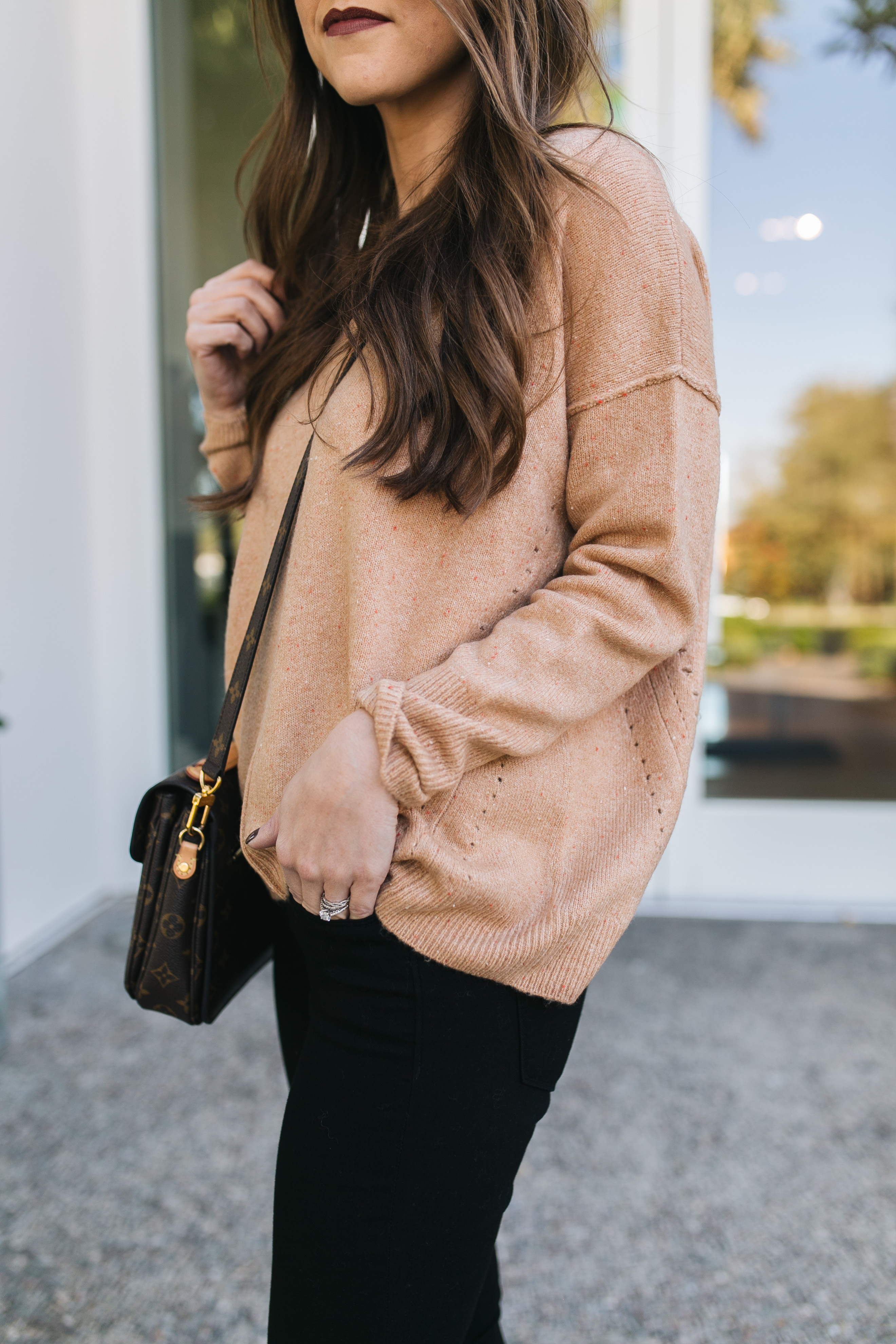 Fashion blogger Daryl-Ann Denner styles a Fall outfit with a Topshop camel sweater, black jeans, leopard flats, and louis vuitton bag