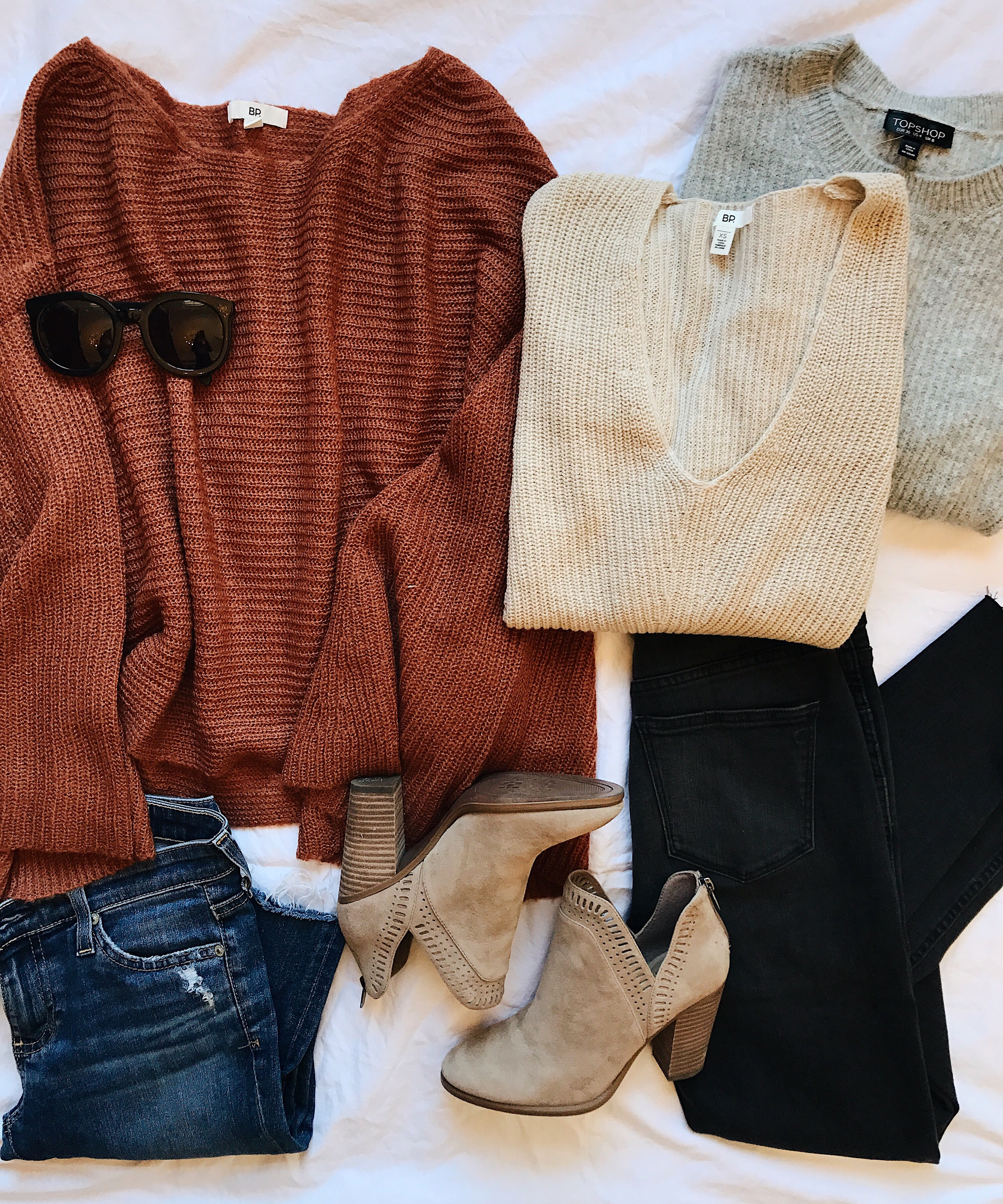 Style blogger Daryl-Ann Denner shares a round-up of fall sweaters including pullovers, cardigans, and other on-trend sweaters for fall 2017