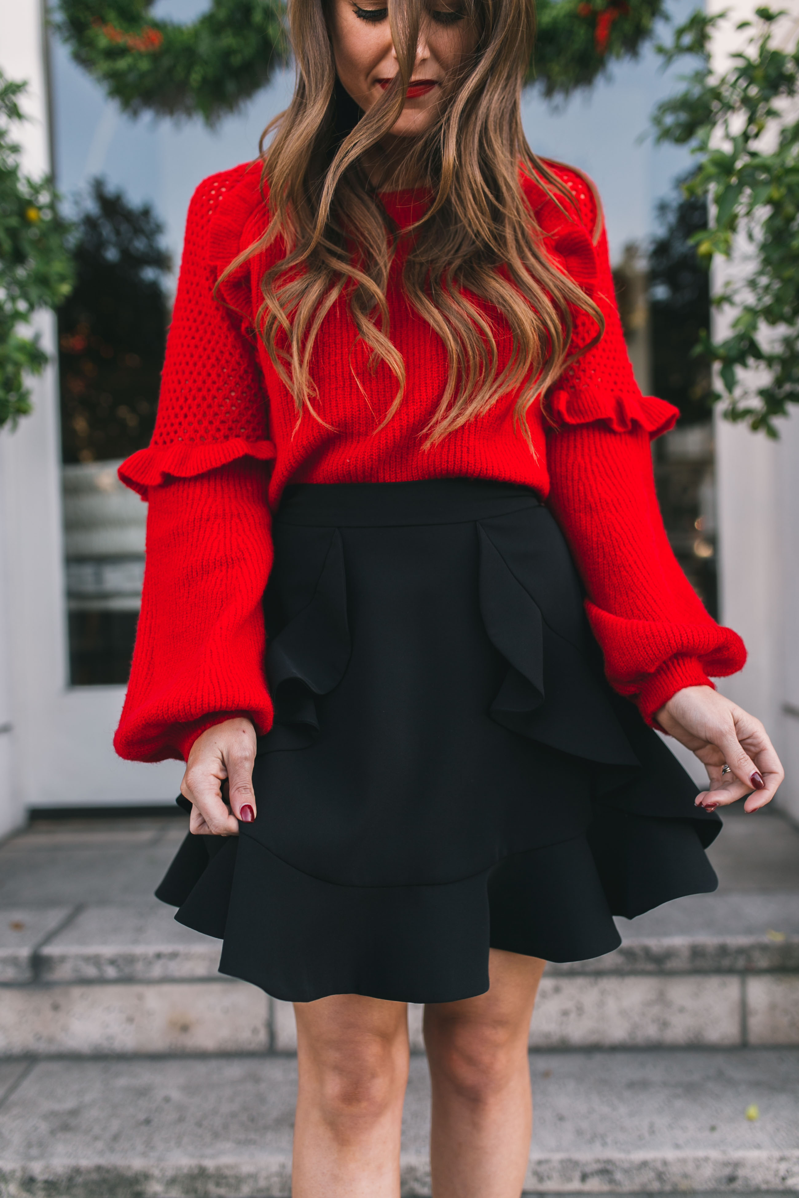 586faa02281 Fashion blogger Daryl-Ann Denner shares festive red sweaters