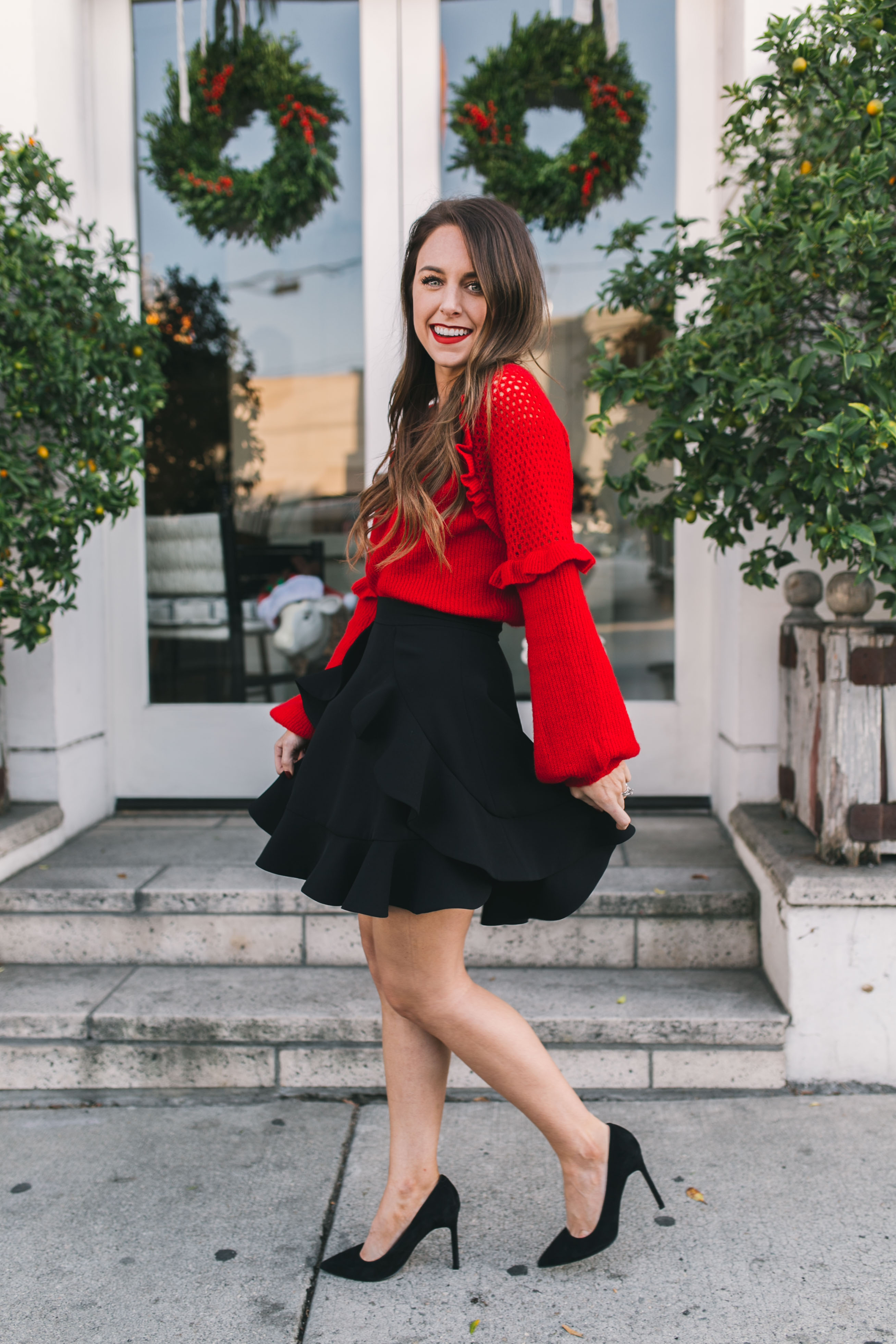 40314a0c6c9 ... black Fashion blogger Daryl-Ann Denner shares festive red sweaters
