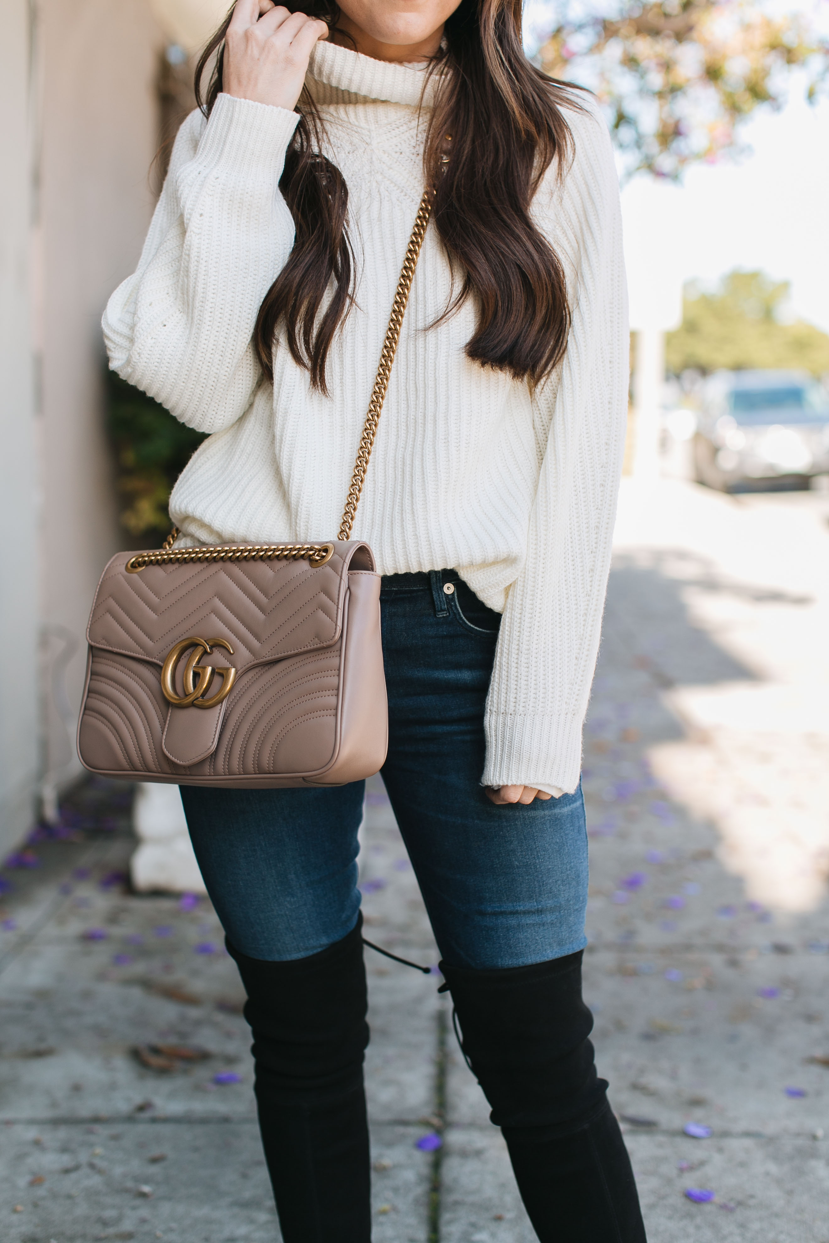 fashion blogger daryl-ann denner shares tips on packing for a weekend getaway and wears a topshop sweater and gucci marmont bag