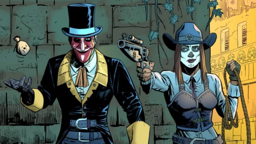 Two mysterious characters, one being a cowgirl with Day-of-the-Dead facepaint, and the other being an industrial-era dressed gentleman.