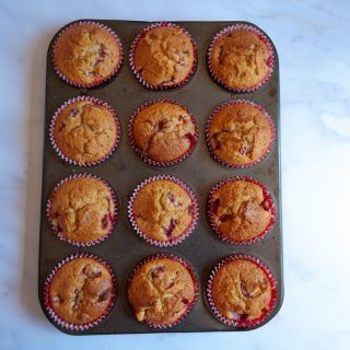 A tray of strawberry and white chocolate muffins