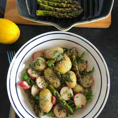 New potato salad with asparagus and radishes