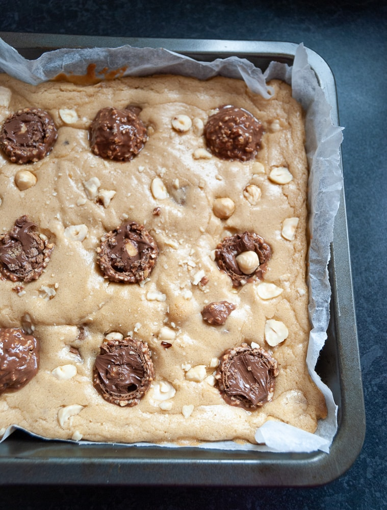 A tray of unbaked Ferrero Rocher blondies