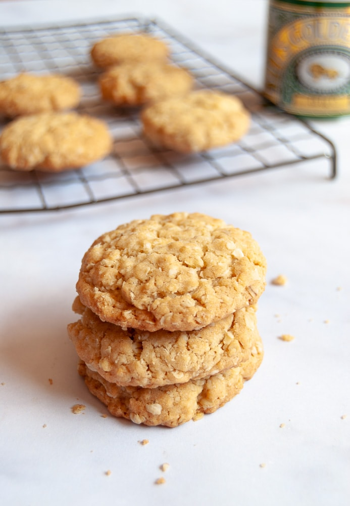 These simple oat biscuits are made with golden sryup for a delicious sweet flavour. Leave them plain or drizzle with melted chocolate for a real treat! #oatbiscuits #oatcookies #easyoatbiscuitrecipe #easyoatcookiesrecipe