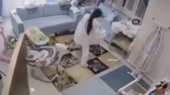 Mom saves child from falling ceiling