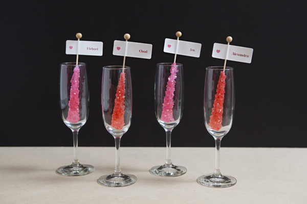 DIY Rock Candy Champagne Glass Seating Cards via Something Turquoise