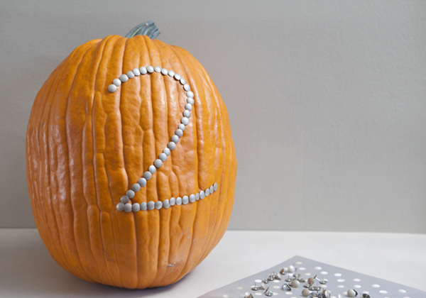 pumpkin and thumbtack table number centerpieces
