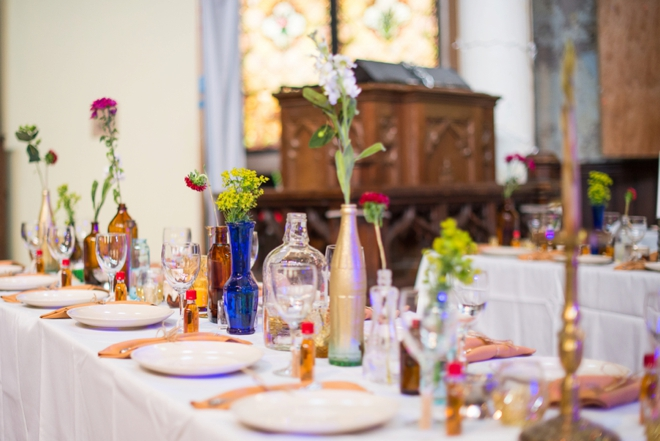 Beautiful DIY boho wedding decor... glass bottles and wildflowers!