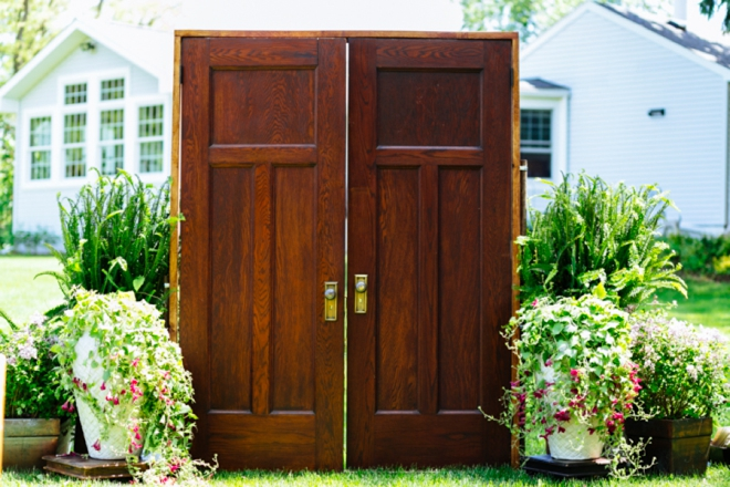 Wood doors to walk through in outdoor ceremony