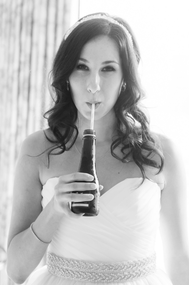 Bride drinking champagne