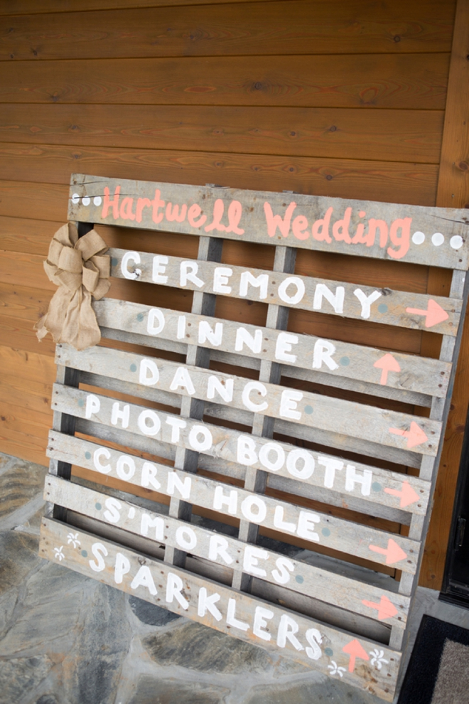 Wedding directional sign painted on a wood pallet!