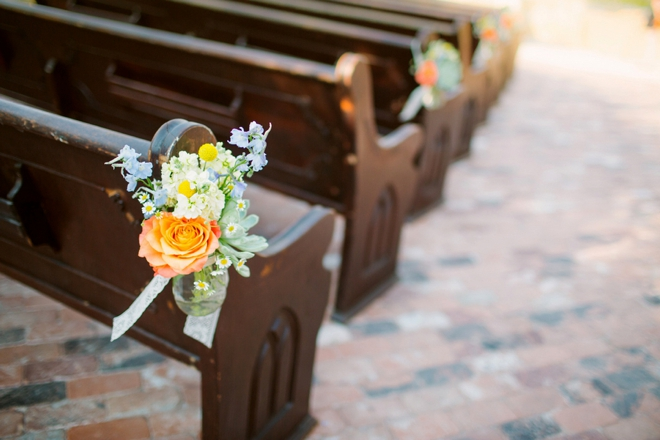 Outdoor pews decorated with flowers