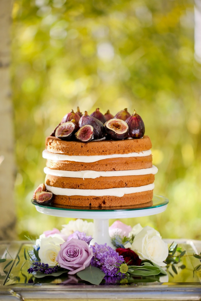 Naked wedding cake with beautiful figs on top