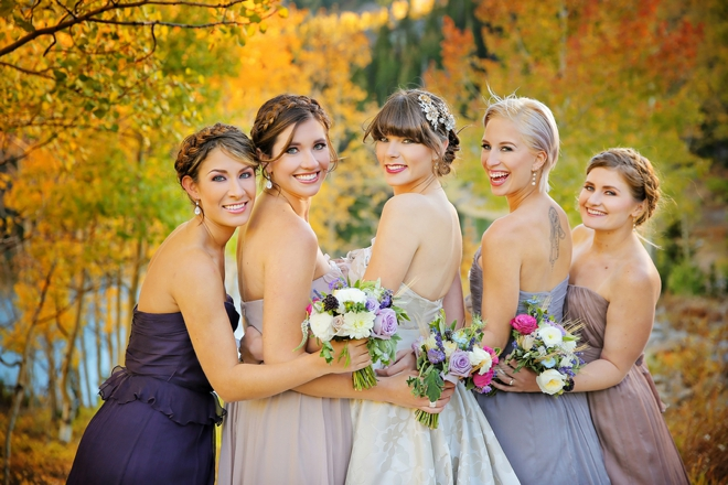 Lovely fall bridesmaids, wearing different purple shades