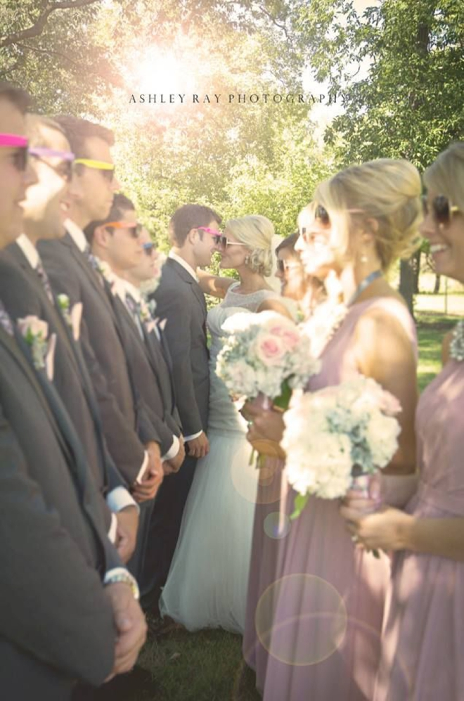 Bridal party in the sun wearing fun sunglasses