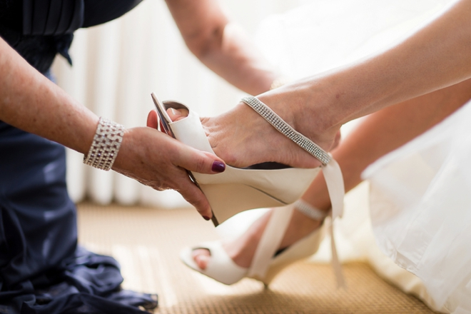 Putting on the brides shoes