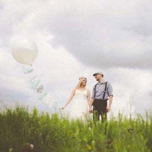Bride and groom with large balloon