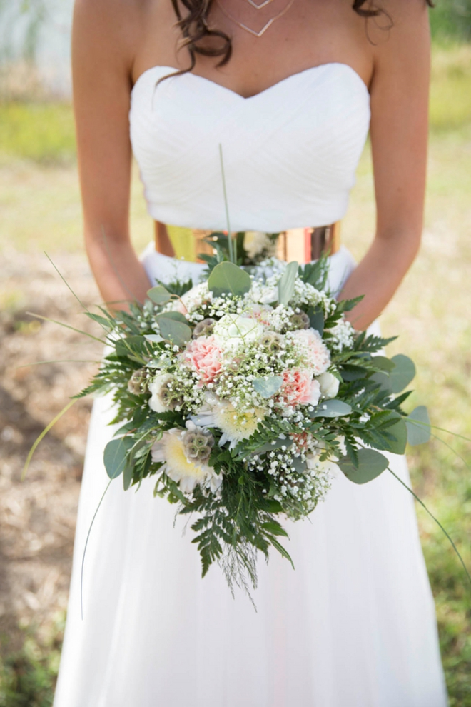 Gorgeous bride with a stunning gold belt and bouquet