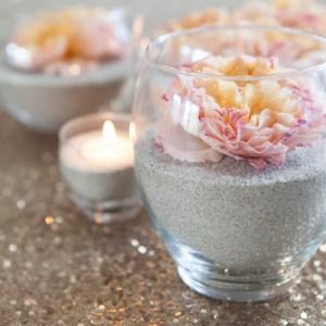 Flowers and sand centerpiece idea