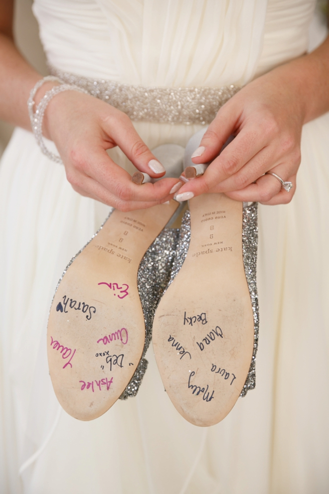 The bridesmaids signed the bottom of her wedding shoes!