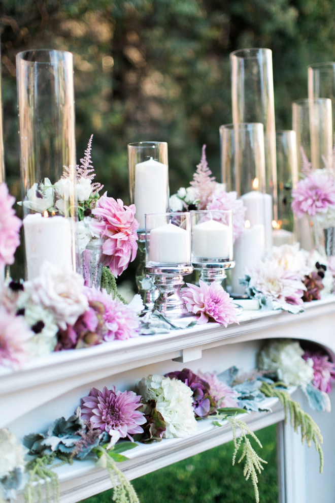 Gorgeous candles and flowers on a mantle for the ceremony