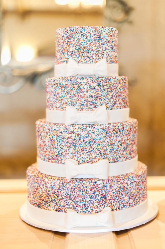 Awesome sprinkle wedding cake with fondant bows