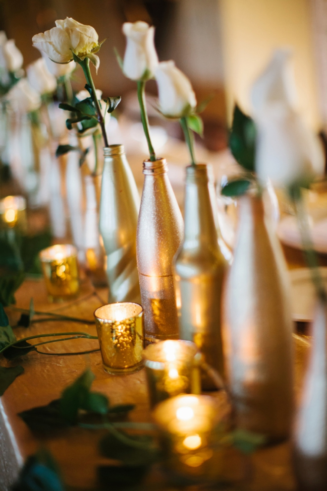 Gorgeous gold bottles on the head table