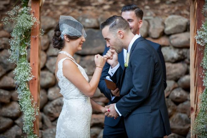 Groom pinky-swearing the bride!
