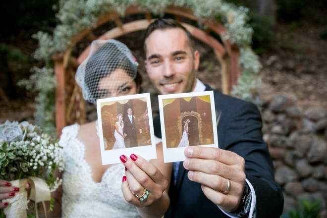 Bride and Groom holding polaroids of themselves