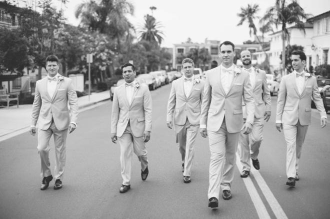 The men... walking to the wedding.