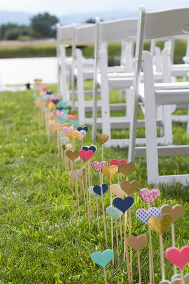 Hearts on sticks as wedding aisle decor!