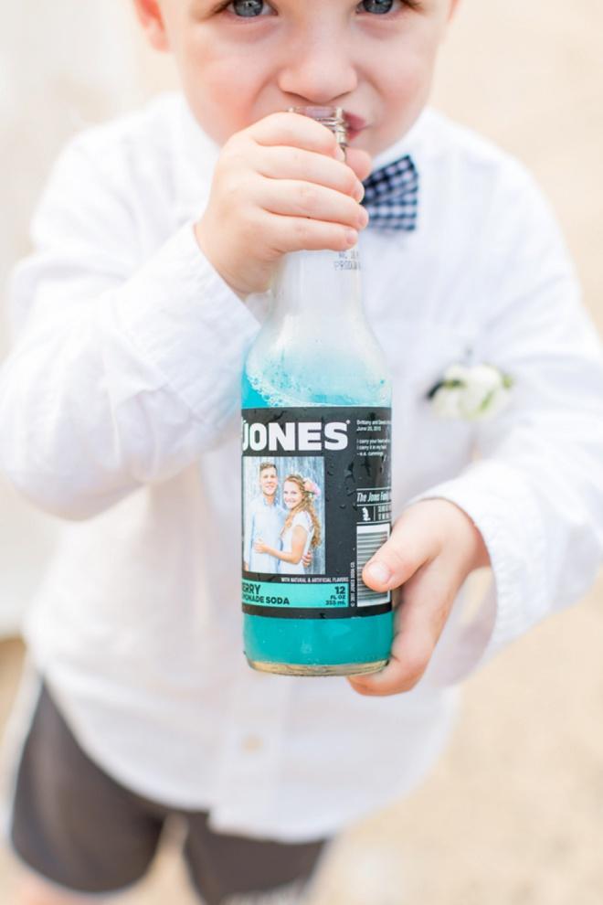 Ring bearer drinking from a custom Jones soda!