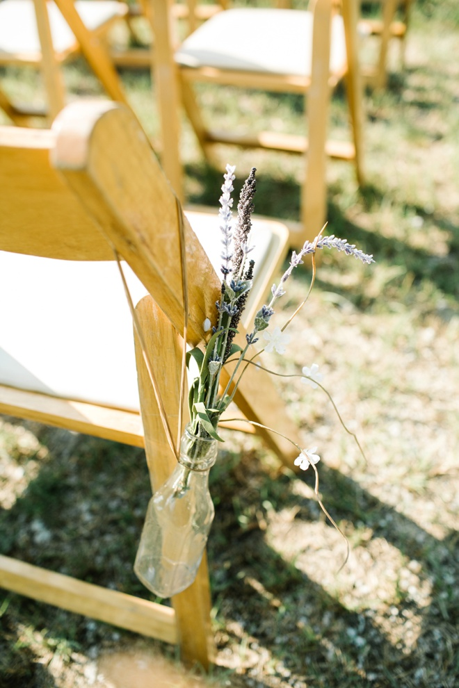 Ceremony seats tied with vintage bottles and sprigs of lavender.