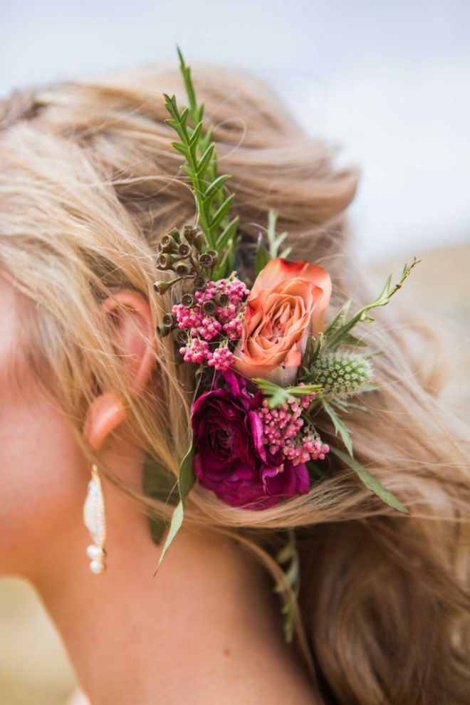 Beautiful wedding hair with flower detail.
