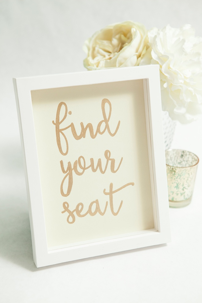 DIY find your seat wedding sign.