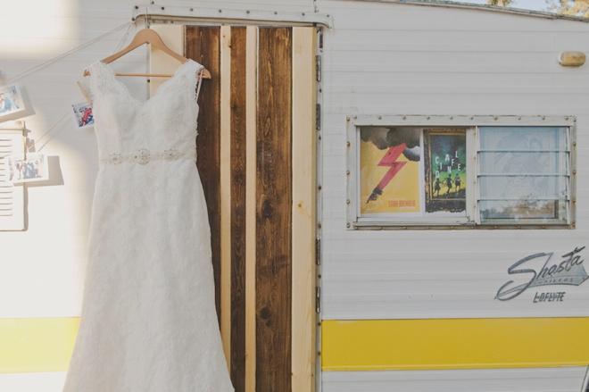 Wedding dress hanging on vintage camper.