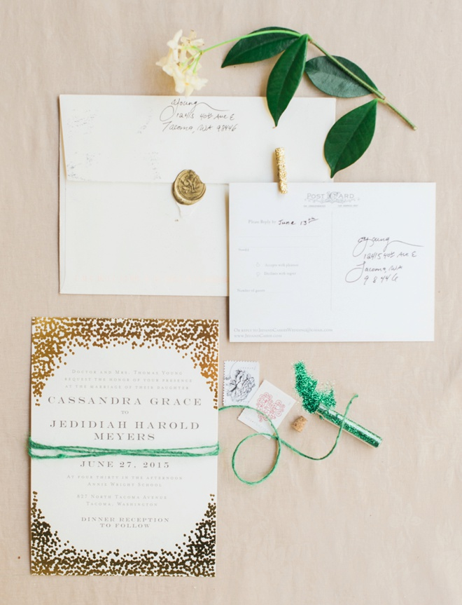 Beautiful gold, cream and eucalyptus green wedding invitations.