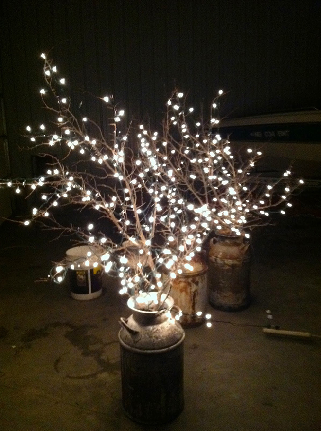 String Lights on branches in milk cans for budget friendly wedding decor