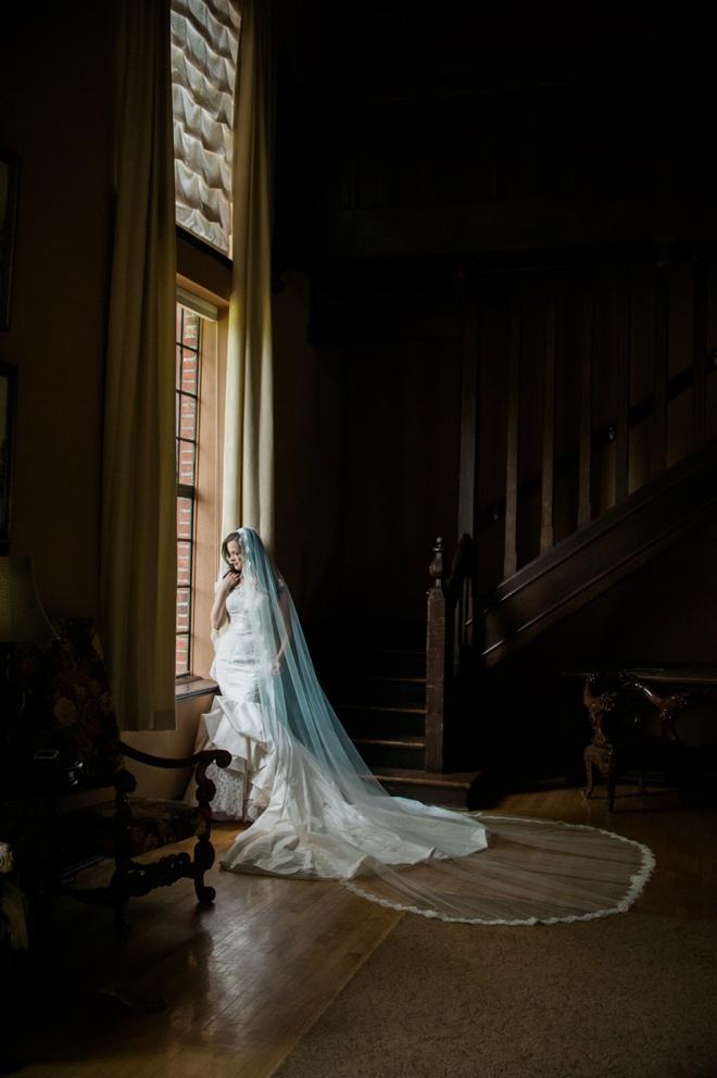 Amazing wedding dress shot in window light.