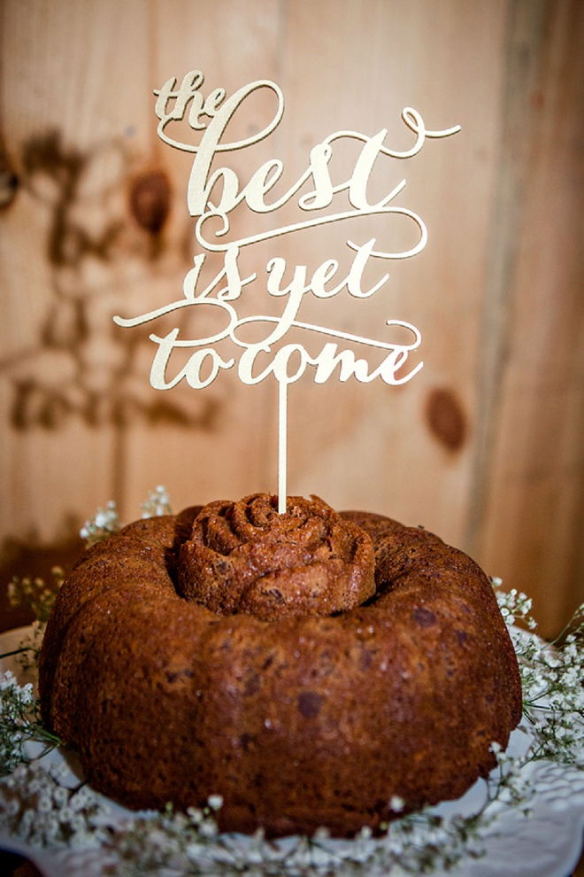 We love this darling homemade wedding cake and gold cake topper!