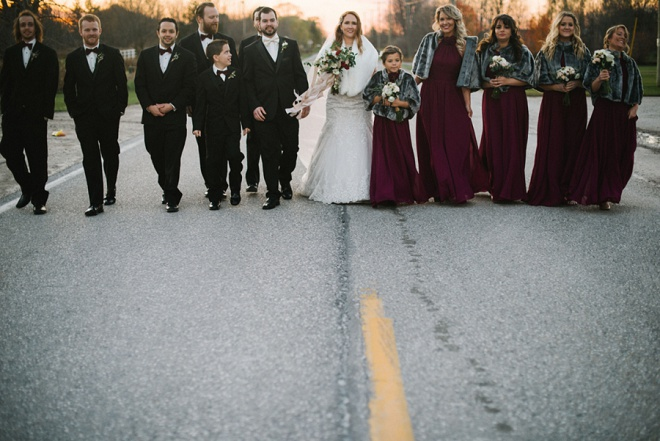 Love this darling shot of the bride, groom and their bridal party!