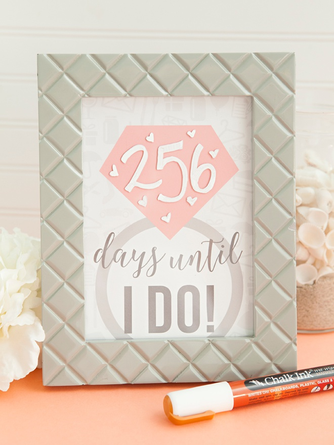 Adorable DIY wedding countdown sign using wet wipe Chalk Ink markers!