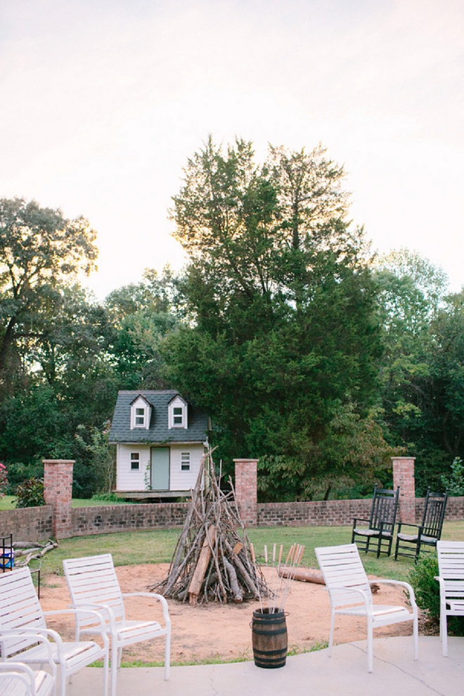 How fun is this firepit at this boho backyard wedding!