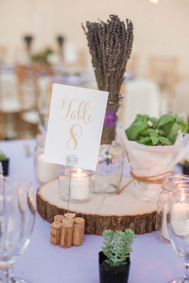 Gorgeous gold table numbers and wooden centerpieces at this DIY desert wedding!