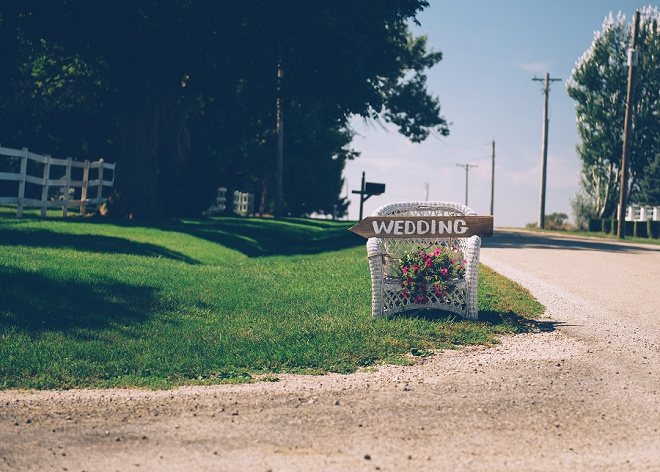 We're loving this gorgeous outdoor barn wedding and the darling hand written signage!